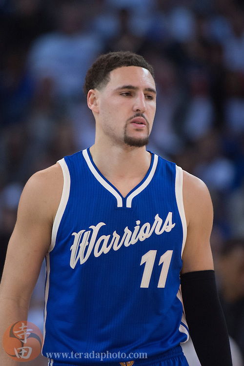 December 25, 2015; Oakland, CA, USA; Golden State Warriors guard Klay Thompson (11) during the second quarter in a NBA basketball game on Christmas against the Cleveland Cavaliers at Oracle Arena. The Warriors defeated the Cavaliers 89-83.