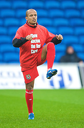 CARDIFF, WALES - Saturday, November 14, 2009: Wales' Robert Earnshaw warms-up wearing a 'Show Racism the Red Card' shirt before the international friendly match against Scotland at the Cardiff City Stadium. (Pic by David Rawcliffe/Propaganda)