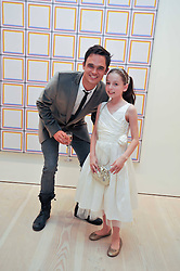 GARETH GATES runner up in first series of the ITV talent show Pop Idol and HOLLIE STEEL finalist in the 2009 TV's X-Factorat an exhibition of photographic portraits by Bryan Adams entitled 'Hear The World' at The Saatchi Gallery, King's Road, London on 21st July 2009.
