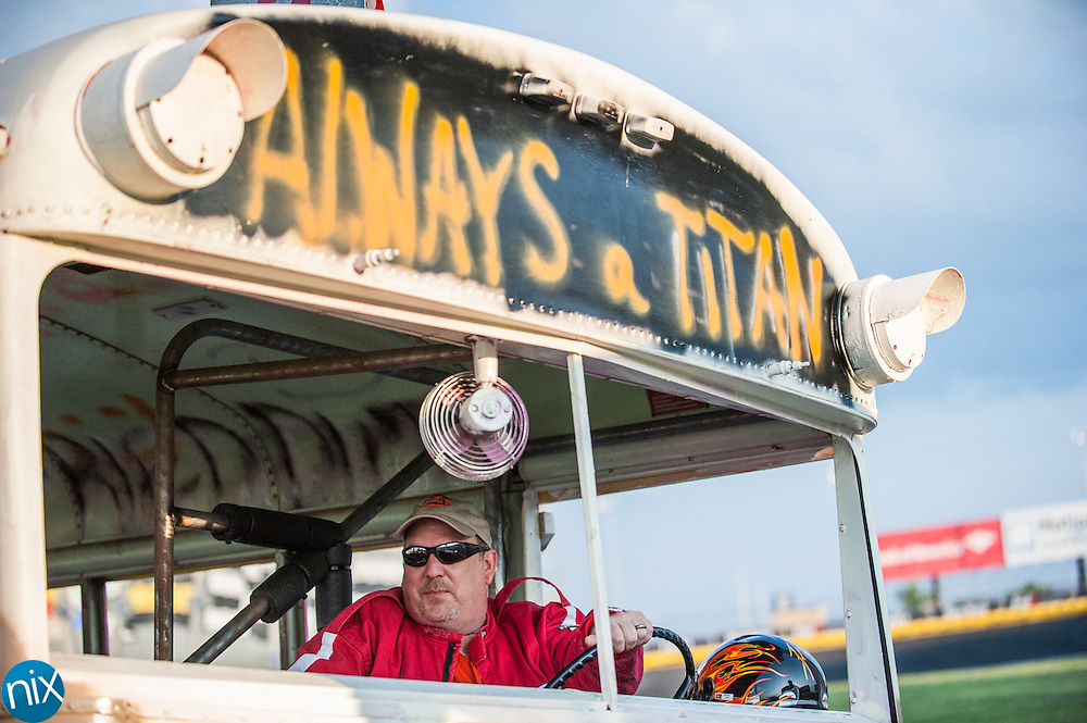 Tim Farrar, principal from Northwest Cabarrus Middle, climbs into his bus during the Principal School Bus Slobberknocker at Charlotte Motor Speedway Tuesday night during the Summer Shootout.