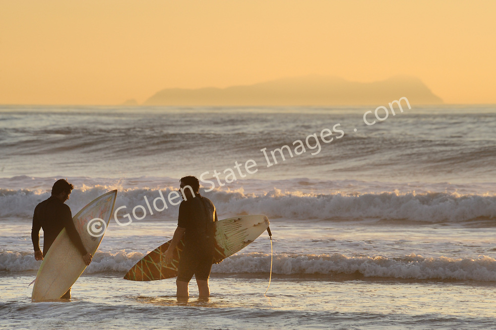 Surfer at the Imperial Beach Pier, South Bay, San Diego<br /> <br /> Not Model Released.