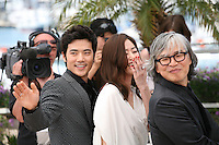 Kim Kang-woo, Kim Hyo-jin, Im Sang-soo,  at The Taste of Money photocall at the 65th Cannes Film Festival France. Saturday 26th May 2012 in Cannes Film Festival, France.