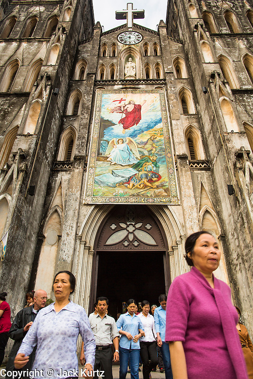 08 APRIL 2012 - HANOI, VIETNAM:     People leave the cathedral after Easter Sunday mass in St. Joseph Cathedral in Hanoi, Vietnam. St. Joseph Cathedral in Hanoi is the seat of the Roman Catholic Archdiocese of Hanoi and is one of the most important Catholic churches in Vietnam. It was built in 1886 and is especially crowded on religious holidays, like Easter. The church holds three Easter masses on Easter Sunday morning. There are more than 5.6 million Roman Catholics in Vietnam, nearly 7% of the population. Catholicism came to what is now Vietnam with Portuguese missionaries in the 16th Century, but it wasn't until the arrival of French missionaries and later colonial authorities that Catholicism became a part of Vietnamese religious life.   PHOTO BY JACK KURTZ