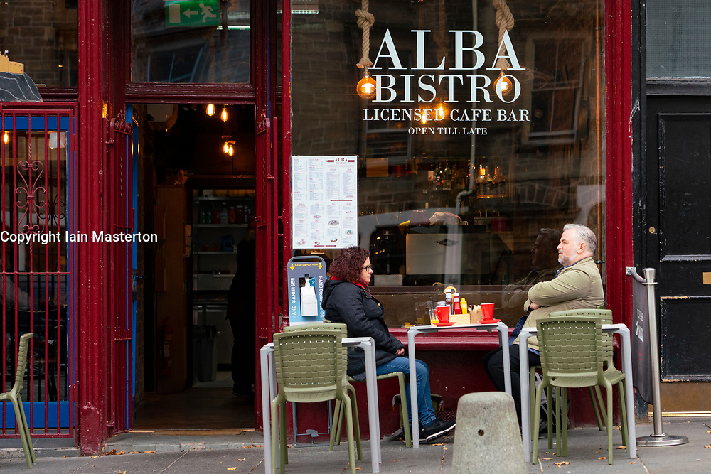 Edinburgh, Scotland, UK. 17 October 2020. Saturday afternoon in Edinburgh city centre during 16 day short circuit lockdown and bars are closed but cafes remain open. Streets in the Old town are very quiet and reminiscent of the eerie emptiness seen during the full lockdown earlier this year. Alba Bistro remains open in the Grassmarket.  Iain Masterton/Alamy Live News
