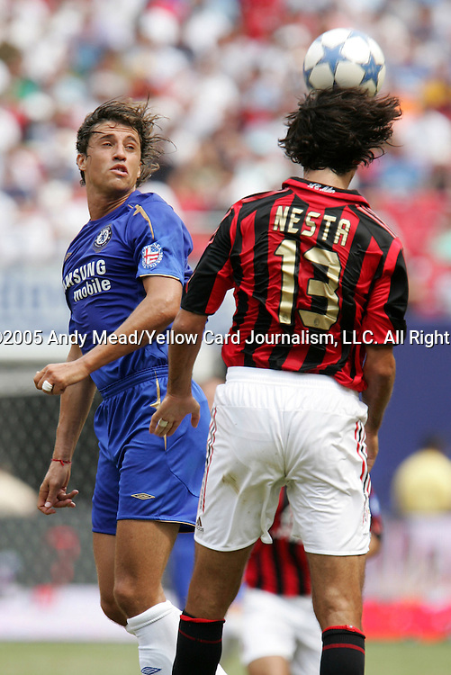 31 July 2005: Alessandro Nesta (13) heads the ball while being challenged by Hernan Crespo (l). Chelsea FC of England and AC Milan of Spain tied 1-1 at Giants Stadium in East Rutherford, New Jersey in an international friendly soccer match as part of AEG's 2005 World Series of Football. .