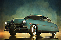 The iconic Hudson Hornet is more than a classic. It is a legendary vehicle that harkens back to a glory era of the American auto. The car got some renewed interest when it was one of the featured characters in the animated Pixar film Cars (and was voiced by another American legend by the name of Paul Newman). This is a compelling scene in which an immovable object stands firmly against the elements. Some might even call it inspiring. Available as wall art, t-shirts, or interior décor products, this is an ideal piece for those who appreciate the greats.<br />