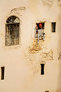 An elderly woman waves out of a window in Fes, Morocco on Monday morning, May 28, 2007. The kind and welcoming people here make this ancient city a true delight to visit. (PHOTO BY TIMOTHY D. BURDICK)