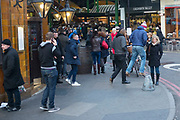Man in mid air at Borough Market, London, UK.