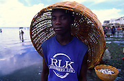 Young basket carrier pictured in the beach that serves as Ilha de Mozambique fishing harbour.
