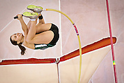 Anna Etherington struggles to make it over the bar during the Women's Pole Vault competition at the NCAA Division III Indoor Track and Field National Championships at Grinnell College.