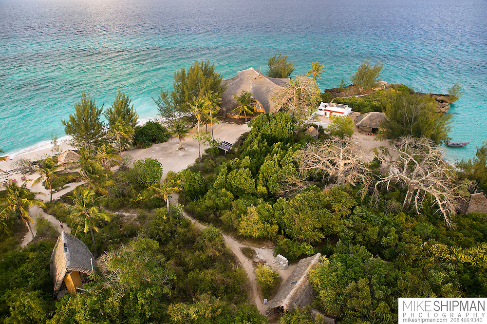 Aerial view of the  main lodge, beach, mosque, one bungalow, and the Baobab trees from the historic 1904 lighthouse. Chumbe Island Coral Park, Zanzibar, Tanzania is an internationally-awarded eco-resort and the first private, not-for-profit marine preserve in the world.
