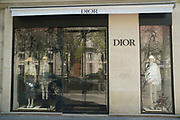 """March, 27th 2020 - Paris, Ile-de-France, France: Paris under confinement, Dior, Avenue Montaigne area of high fashion, beauty, accessories, haute couture, all shops closed, in 8th arrondissement, and all public spaces virtually empty to stop the spread of the Coronavirus, during the eleventh day of near total lockdown imposed in France. The President of France, Emmanuel Macron, said the citizens must stay at home for at least 15 days, that has been extended. He said """"We are at war, a public health war, certainly but we are at war, against an invisible and elusive enemy"""". All journeys outside the home unless justified for essential professional or health reasons are outlawed. Anyone flouting the new regulations is fined. Nigel Dickinson"""