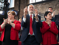 © Licensed to London News Pictures. 31/10/2019. London, UK. Shadow Cabinet members Emily Thornbury (L) and Baroness Chakrabarti applaud with Labour Party Leader Jeremy Corbyn (C) during during an election campaign rally at Battersea Arts Centre. Photo credit: Peter Macdiarmid/LNP