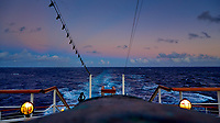 """Sky colors after sunset over the Pacific Ocean from the aft deck of the MV World Odyssey. Unique blue earth shadow and pink """"Belt of Venus"""". Image taken with a Leica T camera and 11-23 mm lens (ISO 200, 23 mm, f/3.5, 1/30 sec)."""