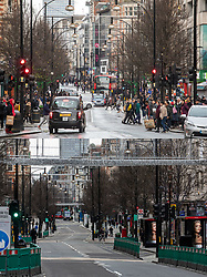 COMBINATION IMAGE © Licensed to London News Pictures. 26/12/2020. London, UK. In this combination image shoppers are seen in a busy Oxford Street on Boxing Day in 2019 (TOP) and the same scene today (LOWER). On one of the busiest shopping days of the year a near deserted Oxford Street as all non-essential shops remain closed due to the continuing coronavirus pandemic that has swept through the World. Last week Health Secretary Matt Hancock announced that yet another new Covid-19 mutation has been discovered in the UK as Downing Street orders many more areas of England to go into Tier 4 lockdown from Boxing Day with tougher new Covid-19 restrictions for many as the mutated strains continue to spread throughout the South East. Photo credit: Alex Lentati/LNP