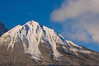 Winter sunrise sets the rugged grandeur of the Canadian Rockies aglow, Banff National Park Alberta Canada