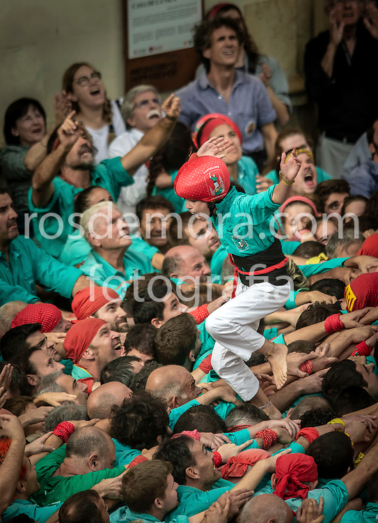 """Members of Castellers de Vilafranca celebrate having finished without falling the human tower """"4 of 9"""", of extreme difficulty in the last performance of the season in Vilafranca del Penedès,Barcelona, Spain. 1st Nov 2019."""
