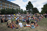 People congregate at Victoria Gardens during the Brighton Pride parade and carnival on the 4th August 2018 in Brighton in the United Kingdom. Brighton Pride is an annual event held in the city of Brighton and Hove, England, organised by Brighton Pride, a community interest company who promote equality and diversity, and advance education to eliminate discrimination against the lesbian, gay, bisexual and transgender community.