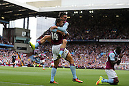 Rudy Gestede of Aston Villa (14) celebrates with teammate Jack Grealish after he scores his teams 1st goal. EFL Skybet championship match, Aston Villa v Rotherham Utd at Villa Park in Birmingham, The Midlands on Saturday 13th August 2016.<br /> pic by Andrew Orchard, Andrew Orchard sports photography.