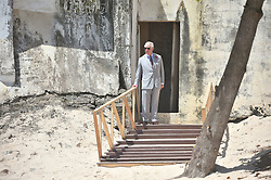 The Prince of Wales stands by a door once used by slaves as they were taken to waiting ships, during a visit to Osu Castle, also known as Fort Christiansborg in Accra, Ghana, on day four of his trip to west Africa with the Duchess of Cornwall.