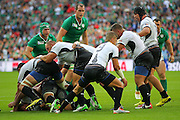 Ireland's Eoin Reddan picks a loose ball up during the Rugby World Cup Pool D match between Ireland and Romania at Wembley Stadium, London, England on 27 September 2015. Photo by Phil Duncan.