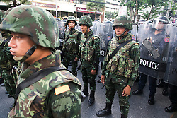 © Licensed to London News Pictures. 24/05/2014. Thai Soldiers form a line of defence following a Anti-Coup protest in Bangkok Thailand. The Royal Thai army announced a Military coup and have imposed a 10pm curfew.  Photo credit : Asanka Brendon Ratnayake/LNP