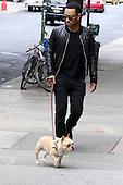 John Legend walking his dog Pippa