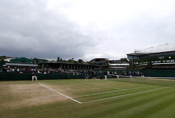 General view of the wear and tear to the grass on the baseline of court eleven on day eight of the Wimbledon Championships at The All England Lawn Tennis and Croquet Club, Wimbledon.