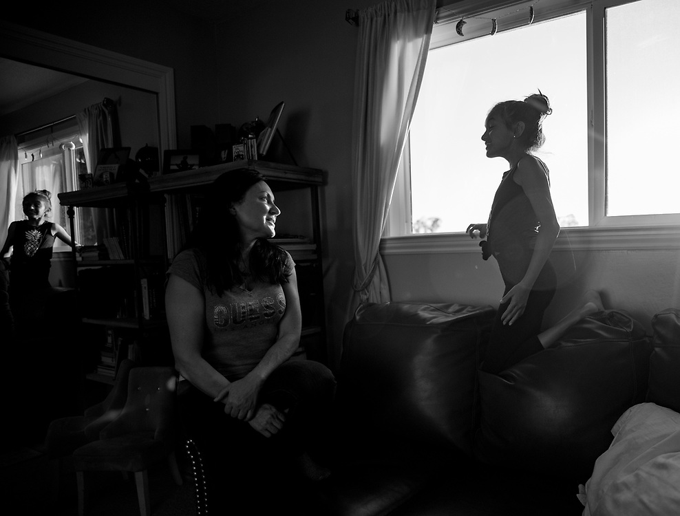 """Veronica Ramirez, left, smiles at Bella, inside her late-son's bedroom as the sun goes down on March 28, 2018. <br /> <br /> """"Every day I try to watch the sunset in Nikko's room,"""" Ramirez says. """"Bella prays with me at night. She always asks God to help me with my pain. I feel like I need to heal for Bella, because she sees me suffering. I guess we bounce off each other, because she really helps my husband and I."""""""