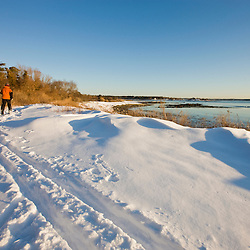 A man cross country skiing on the coast at Odiorne Point State Park in Rye, New Hampshire.