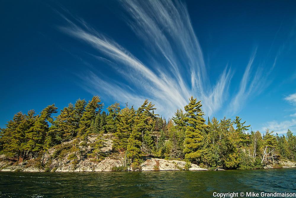White pine trees (Pinus storbi) and mare's tail clouds on Crow (Kakagi) Lake<br /> Near Nestor Falls<br /> Ontario<br /> Canada