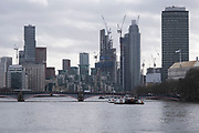 New and recently built high rise residential apartment buildings along the River Thames looking towards Vauxhall on 28th January 2021 in London, United Kingdom. This area along the riverfront is slowly filling with skyscrapers and with new ones under construction.