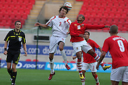 Robert Earnshaw of Wales battles for the ball with Lars Gerson of Luxembourg.  friendly international match, Wales v Luxembourg at the Parc y Scarlets stadium in  Llanelli on Wed 11th August 2010. pic by Andrew Orchard, Andrew Orchard sports photography,