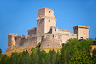The medieval battlements of the Rocca Maggiore castle on the hilltop above Assisi, Italy .<br /> <br /> Visit our ITALY HISTORIC PLACES PHOTO COLLECTION for more   photos of Italy to download or buy as prints https://funkystock.photoshelter.com/gallery-collection/2b-Pictures-Images-of-Italy-Photos-of-Italian-Historic-Landmark-Sites/C0000qxA2zGFjd_k .<br /> <br /> Visit our MEDIEVAL ART PHOTO COLLECTIONS for more   photos  to download or buy as prints https://funkystock.photoshelter.com/gallery-collection/Medieval-Middle-Ages-Art-Artefacts-Antiquities-Pictures-Images-of/C0000YpKXiAHnG2k