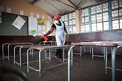 South Africa - Durban - 21 May 2020 - Some of the schools across the country have started with the process of sanitizing & disinfecting the classrooms like Thembokuhle Shezi working at Ekuthuleni primary school prior the first of June 2020 school reopening. following the Coronavirus COVID-19 lockdown adjustment of regulations to curb the spread of coronavirus.<br /> Picture: Motshwari Mofokeng/African News Agency(ANA)