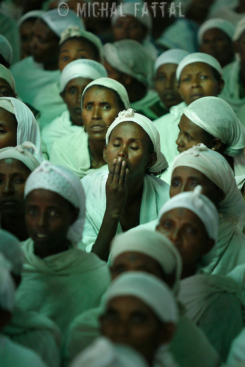 Ethiopian women pray early Saturday morning at the synagogue of the NACOEJ (North American Conference on Ethiopian Jewry) communit center in Gondar, Ethiopia, May 2008.