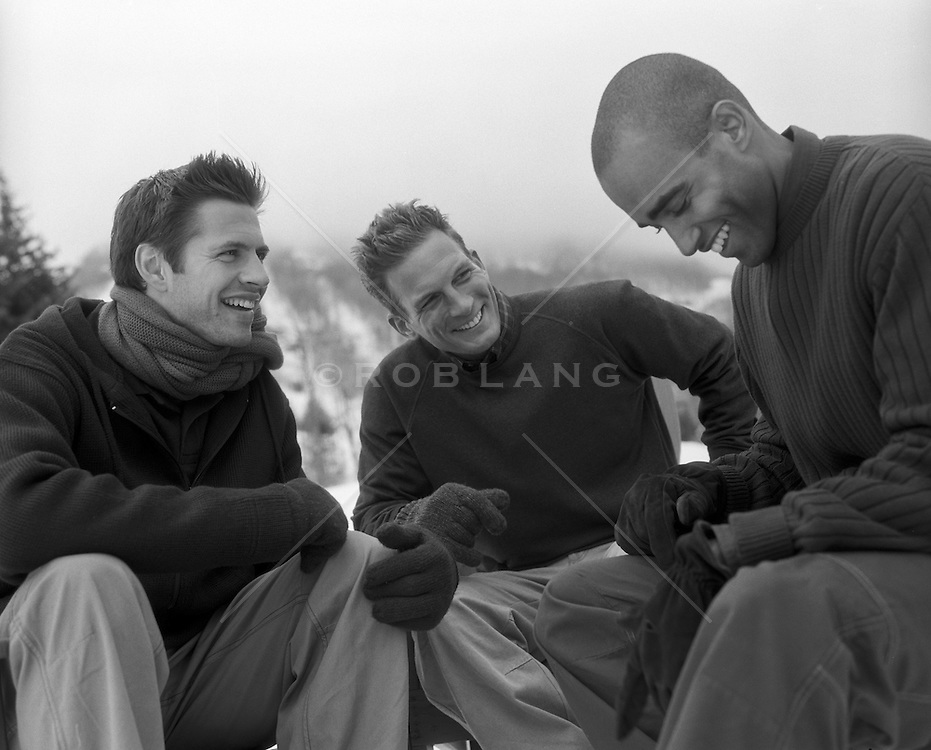 three guys enjoying time together outdoors in the Wintertime