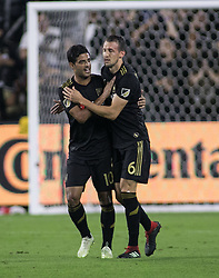 November 1, 2018 - Los Angeles, California, U.S - Danilo Silva #6 of the LAFC is congratulated by Carlos Vela #10 after scoring a goal during their MLS playoff game with the Real Salt Lake on Thursday November 1, 2018 at Banc of California Stadium in Los Angeles, California. LAFC vs Real Salt Lake. (Credit Image: © Prensa Internacional via ZUMA Wire)