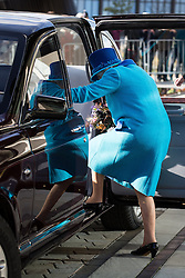 © Licensed to London News Pictures . 14/11/2013 . Manchester , UK . The Queen boards her shiny car . Queen Elizabeth II and the Duke of Edinburgh visit the Coop building at 1 Angel Square , Manchester , this morning ( 14th November 2013 ) . Photo credit : Joel Goodman/LNP