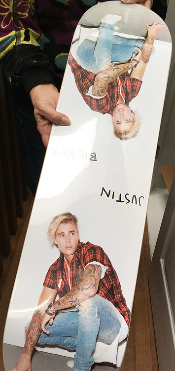 """Justin Bieber will be honored by his Canadian hometown with the launch of a new museum exhibition featuring memorabilia from his past. The Stratford Perth Museum, located in southwestern Ontario, promises a """"behind the scenes look"""" at the 23-year-old singer's meteoric rise to success. Visitors will be able to see a wide array of artifacts provided by Bieber and his relatives, as well as other Stratford residents who have connections with him. The collection includes dozens of pieces from his music career, such as Grammy awards, Teen Choice Awards, a personal letter from former First Lady Michelle Obama and clothing he wore during major concert performances. It will also feature personal items from his childhood in Stratford, including a hockey jacket he wore when he played for the Stratford Warriors Peewee Travel Team as well as photos and videos. No stone has been left unturned as even Bieber's old sneakers have made the cut and feature in the exhibition. The exhibit, which opens on February 18, is called """"Steps to Stardom,"""" in reference to the steps of Stratford's Avon Theatre where Bieber used to sing and play his guitar as a young busker. A video posted to YouTube of him performing on those steps garnered millions of views and ultimately helped him land his first recording contract as a 13-year-old wannabe star. John Kastner, General Manager of the Stratford Perth Museum, said: """"We're very excited about this exhibit and helping to share a fascinating story about a hometown hero who's gone on to remarkable achievements. """"We're grateful to Justin and his family for supporting what we wanted to do and allowing us to share a piece of their lives with the world."""" The museum, which typically receives approximately 7,000 visits per year, is expecting the exhibit to generate significant interest among Bieber's following of dedicated fans across North America and around the world. """"The single biggest question we get from visitors at the muse"""
