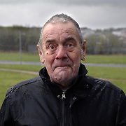 Man in Easterhouse. At bus stop. Glasgow.<br /> . .Picture Robert Perry 25th April 2010<br /> <br /> Must credit photo to Robert Perry<br /> FEE PAYABLE FOR REPRO USE<br /> FEE PAYABLE FOR ALL INTERNET USE<br /> www.robertperry.co.uk<br /> NB -This image is not to be distributed without the prior consent of the copyright holder.<br /> in using this image you agree to abide by terms and conditions as stated in this caption.<br /> All monies payable to Robert Perry<br /> <br /> (PLEASE DO NOT REMOVE THIS CAPTION)<br /> This image is intended for Editorial use (e.g. news). Any commercial or promotional use requires additional clearance. <br /> Copyright 2014 All rights protected.<br /> first use only<br /> contact details<br /> Robert Perry     <br /> 07702 631 477<br /> robertperryphotos@gmail.com<br /> no internet usage without prior consent.         <br /> Robert Perry reserves the right to pursue unauthorised use of this image . If you violate my intellectual property you may be liable for  damages, loss of income, and profits you derive from the use of this image.
