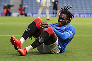 Calvin Bassey (Rangers) feels a bit pain during the Scottish Premiership match between Rangers and Livingston at Ibrox, Glasgow, Scotland on 25 October 2020.