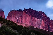 Magenta sunrise illuminates the Towers of Paine seen from Refugio Chileno, in Ultima Esperanza Province, Chile, Patagonia, South America. The salmon dinner & dessert served at Refugio Chileno was our tastiest meal along the W Route! Torres del Paine National Park is listed as a World Biosphere Reserve by UNESCO.