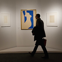 "BRESCIA, ITALY - FEBRUARY 11:  A visitor walks in front of ""Venus"" by Matisse at the  Santa Giulia Museum on February 11, 2011 in Brescia, Italy. The exhibition ""Matisse La Seduzione di Michelangelo"" shows  180 works of the French artist and will stay open until June 12th 2011"