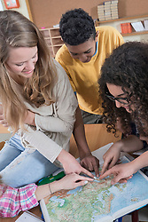 University students pointing in map in classroom, Bavaria, Germany