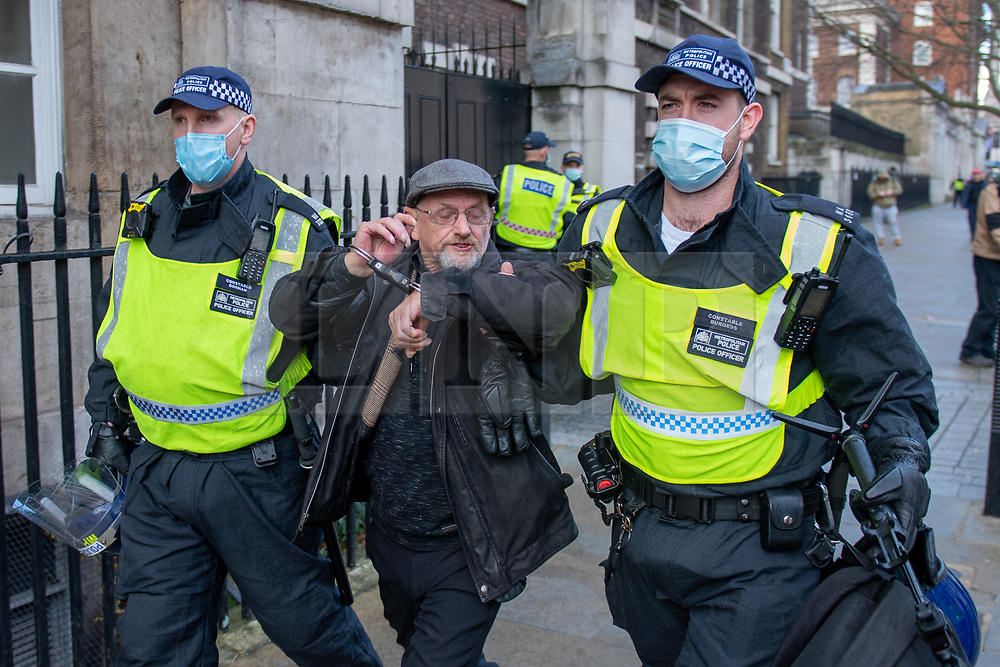 © Licensed to London News Pictures. 19/12/2020. London, UK. A protester is arrested on Whitehall. Protesters have gathered in central London for an anti-lockdown demonstration. Photo credit: Peter Manning/LNP