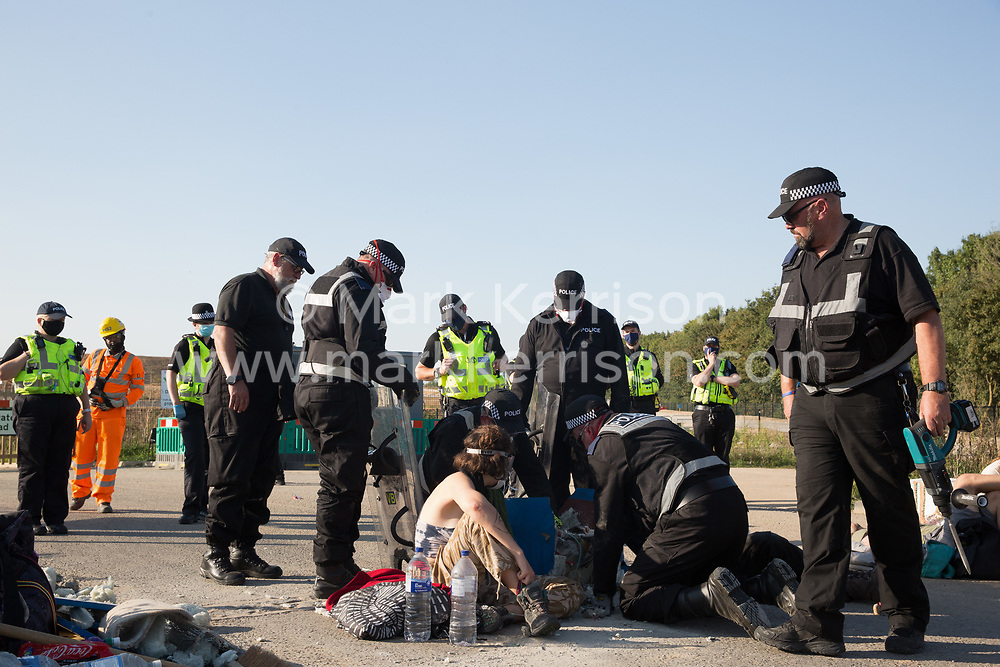 West Hyde, UK. 14th September, 2020. A Hertfordshire Police cutting team works to remove two environmental activists from HS2 Rebellion who used a lock-on arm tube to block a gate to the South Portal site for the HS2 high-speed rail link. Anti-HS2 activists blocked two gates to the same works site for the controversial £106bn rail link, one remaining closed for over six hours and another for over nineteen hours.