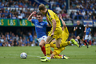 Portsmouth Forward, Oliver Hawkins (9) tripped by Oxford United Defender, Jamie Hanson (6) for a penalty during the EFL Sky Bet League 1 match between Portsmouth and Oxford United at Fratton Park, Portsmouth, England on 18 August 2018.