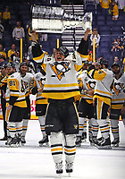 NASHVILLE, TN - JUNE 11:  Carl Hagelin #62 of the Pittsburgh Penguins celebrates with the Stanley Cup trophy after defeating the Nashville Predators 2-0 in Game Six of the 2017 NHL Stanley Cup Final at the Bridgestone Arena on June 11, 2017 in Nashville, Tennessee.  (Photo by Frederick Breedon/Getty Images)