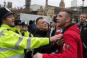 A Brexiteer yells at a police officer on Brexit Day, the day when the UK legally leaves the European Union, in Westminster, on 31st January 2020, in London, England.
